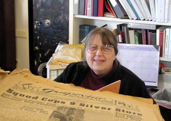 Liisa Penner, deep in research, is a recipient of a 2012 Oregon Heritage Excellence Award.