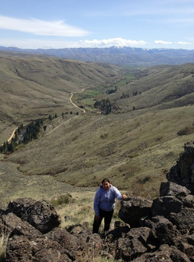 The author summiting a ridge in ceded homelands of the CTUIR, Eastern Oregon.