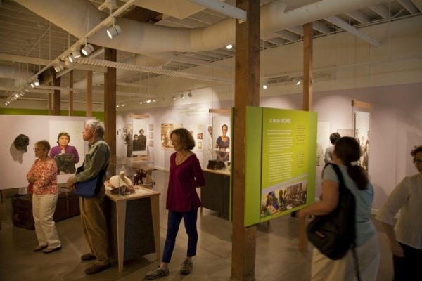 Visitors attend the Settling In exhibit at the Oregon Jewish Museum.