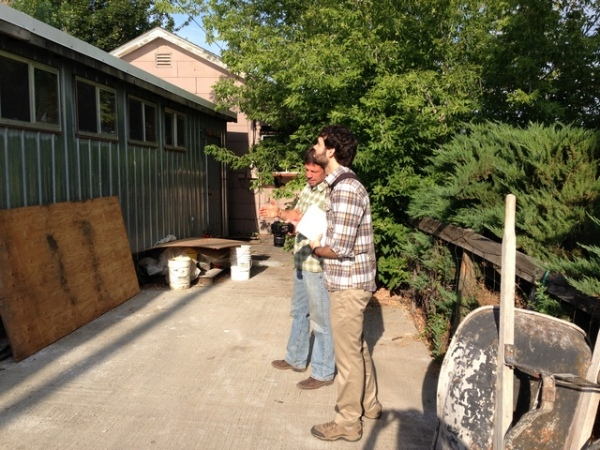 David (right) in Lostine visiting with a property owner about a historic building.
